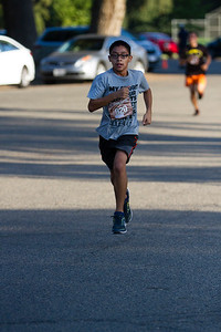 Jose Juarez  (920) of Visalia finishes the  2nd Annual Visalia Hot Fudge Sundae 5K  Run. Juarez was the third place finisher in for males , age 19 and under.