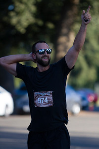Curtis Medina (974) of  Visalia celebrates finishing the 2nd Annual Visalia Hot Fudge Sundae Run in Mooney  Grove Park in Visalia.