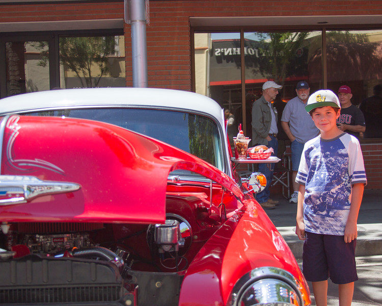Jacob, 10, admires the (fake) refreshments on this classic Chevrolet at the 29th Annual Downtown Visalia Car Show.