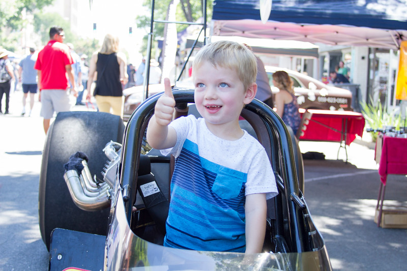 Sitting in a dragster gets a thumbs-up at the 29th Annual Visalia Downtown Car Show.