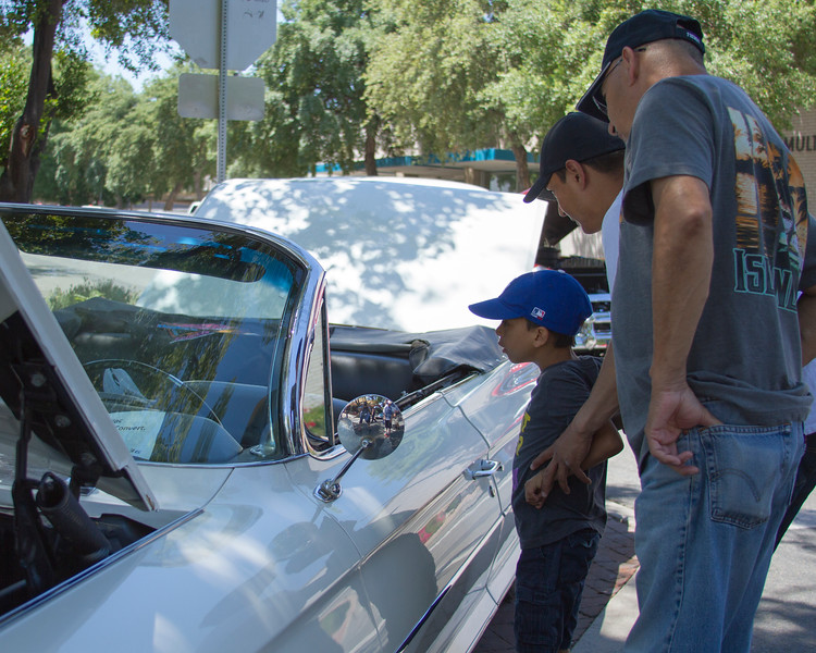 Three generation of car enthusiasts check out this vintage Chevrolet Impala at the 29th Annual Downtown Visalia Car Show held Saturday, May 20th on Visalia's Main Street.