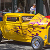 While Dad inspects the interior, son gets a birds-eye-view of one of the 345 cars at the 29th Visalia Downtown Car Show.