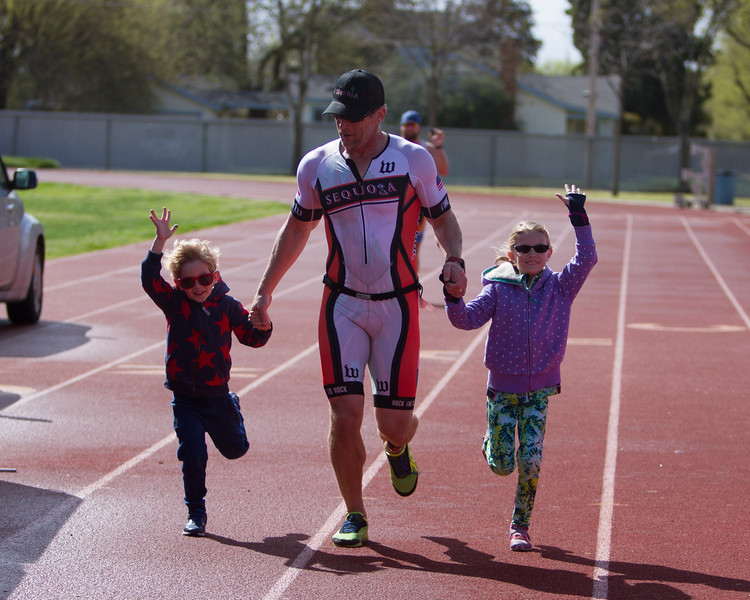 The 2016 edition of the Rocky Hill Triathlon was held on Sunday, March 6th. Olympic length participant, and race organizer, James Wilson of Exeter crosses the finish line with his children.