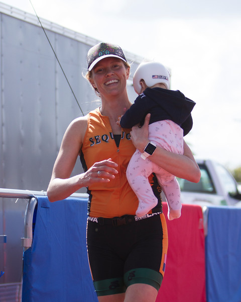 The 2016 edition of the Rocky Hill Triathlon was held on Sunday, March 6th.  Rachel Duby, of Exeter, crosses the finish line with her daughter in her arms. Rachel placed 2nd in the Women's Sprint distance.