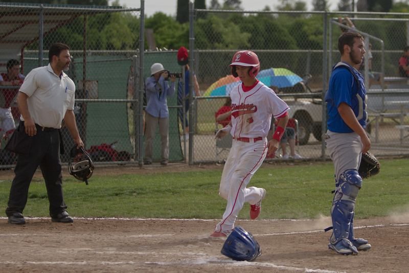 Lindsay's Issac Macias crosses the plate for the Cardinal's 2nd run in their ESL contest against the Corcoran Panthers. Lindsay jumped to an early 3-1 lead against the Panthers, but Corcoran was able to come back and with the contest 5-3 in 8 innings.