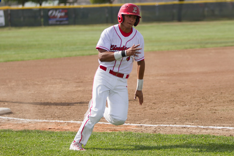Lindsay Cardinal Israel Uribe scored the Cardinal's first run against the Corcoran Panthers on Thursday, April 30th. The Cardinals lost in an extra innings contest by a 5-3 score.