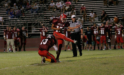 Lindsay's Carlos Valdavinos, (15) kicks an extra point after an East touchdown during the East vs. West Tulare-Kings All-Star Football game on Saturday, June 222, 2013.