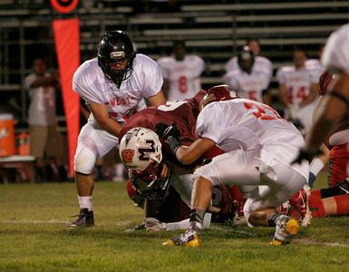 Strathmore's running back Cody Styles is tackled after a short gain during the Tulare/Kings County All Star Football game at Bob Mathias Stadium in Tulare on Saturday, June 22, 2013.