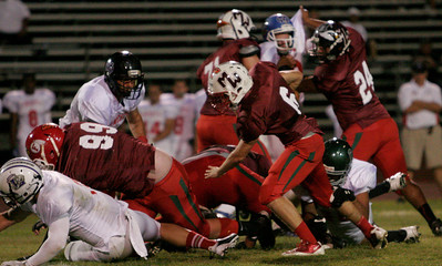Strathmore running back Cody Styles (6) rushes the football for the East All-Star team during the East vs. West Tulare-Kings All-Star Football game at Bob Mathias Stadium in Tulare on Saturday, June 22, 2013.
