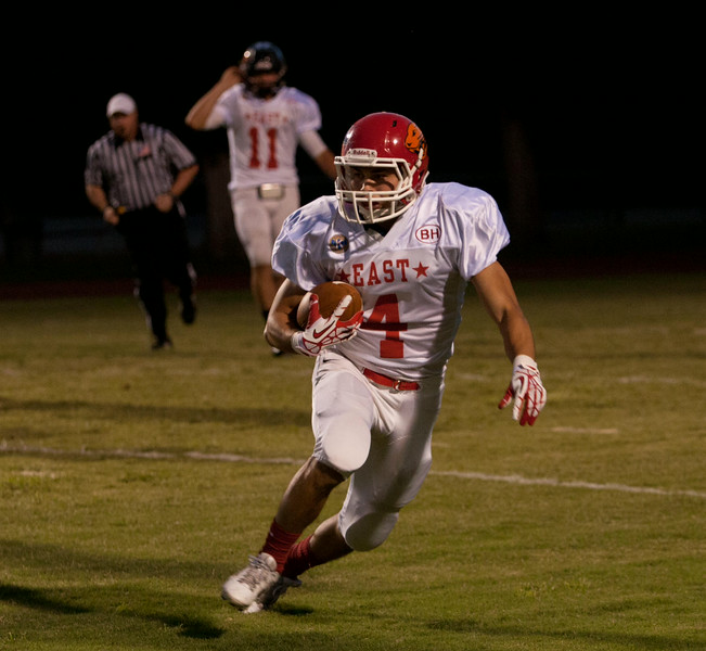 Lindsay Runningback Jacob Hernandez (4) breaks a long run during the 47th Annual East vs. West Tulare-Kings All Star Football Game.