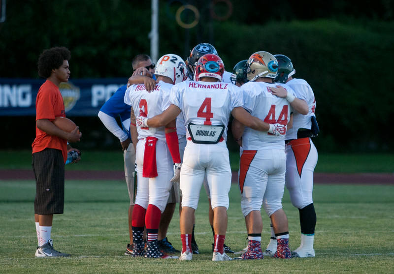Strathmore's Ricardo Madrigal (2), Lindsay's Jacob Hernandez (4), Monache's Nicholas Aguilar (44), and several other East team all-stars share a moment before the 47th Annual East vs. West Tulare-King Football All-Star Game on July 25, 2014.