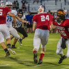 East All Star QB Michael Nava (16) of Cesar Chavez High School hands the ball to Central Valley Christian RB Mac Garbani (24) during the playing of the 48th Annual Tulare-Kings All Star Football Game held on Saturday, June 27, 2015.