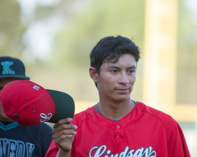 The 56th Exeter Lions East vs. West High School All-Star Baseball Game was played at Rawhide Stadium in Visalia on Saturday, June 4, 2016.  Lindsay's outstanding pitcher Alfredo Vasquez tips his cap to the crowd at pre-game introductions. Vasquez would pitch the 1st and 2nd innings for the East all-star team.