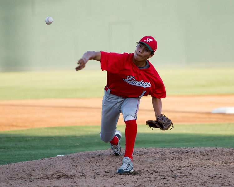 The 56th Exeter Lions East vs. West High School All-Star Baseball Game was played at Rawhide Stadium in Visalia on Saturday, June 4, 2016. Lindsay pitcher Alfredo Vasquez throws a curve ball during early action in the all-star game.