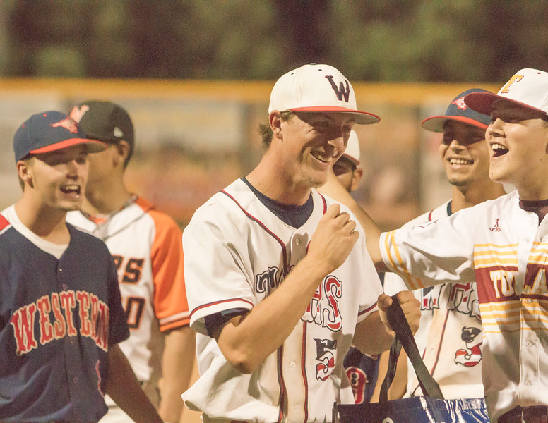Tulare Western's Wyatt Gilbert reacts to being named the MVP of the 57th Annual East West All-Star Baseball Game. Gilbert pitched 3 scoreless innings, striking out 2. He also had two hits, a single and a triple. and scored a run.