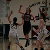 Strathmore Spartan Shelby Vanasen passes the basketball over Exeter Monarchs Danica Todd (23) and Cheyenne Will (20) at the Tulare Mid-Winter Show.