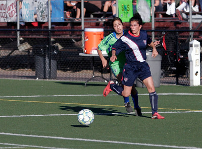 Woodlake HS's Ruth Galvan looks to pass to another East player during the Tulare & Kings County Soccer All-Star game.