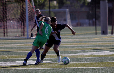 Farmersville's Stephanie Alba drives the ball against Ashlee Demascio of Redwood High School at the 5th Annual Tulare & Kings County Soccer All-Star game.