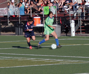 Ruth Galvan, in blue, of Woodlake attempts to catch up as the West all-stars move the soccer ball in the 5th Annual Tulare and Kings County Soccer All-Star game.