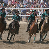 The Tulare County Cowgirls Drill Team performs during a break in the 61st Annual Woodlake Lions Rodeo.