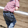 This young cowboy gets a closer look at the action during the 61st Annual Woodlake Lions Rodeo on May 10-11, 2014.