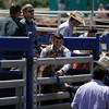 A rodeo contestant has a light moment with the gate handler before getting down to business at the 61st Annual Woodlake Lions Rodeo.
