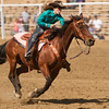 A barrel racer streaks for the timing line during the open barrel race at the 2015 Woodlake Lions Club Rodeo on May 9-10.