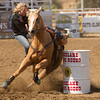A barrel racer takes a tumble off her mount during the 62nd edition of the Woodlake Lions Rodeo on May 9.