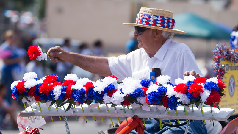 This Farmersville Memorial Day Parade participant gave red, white, and blue carnations to many of the women along the parade route.