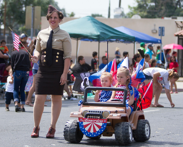 Many of the participants in the 63rd Farmersville Memorial Day Parade were dressed in military uniforms, others in red, white, and blue.