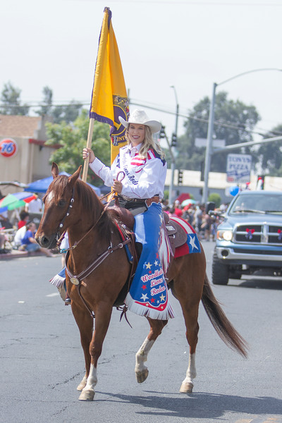 2017 Woodlake Lions Rodeo Queen Kelsey Story is all smiles as the rides her horse down the parade route at the 63rd Annual Farmersville Memorial Day Parade.