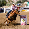The 65th Annual Woodlake Lions Club Rodeo took place on Mother's Day weekend at the Woodlake Rodeo grounds in Elderwood. Barrel racers must complete a clover-leaf pattern around 3 barrels as fast as possible. If they knock down a barrel, they receive a 5-second penalty.