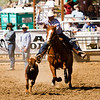 The 65th Annual Woodlake Lions Club Rodeo took place on Mother's Day weekend at the Woodlake Rodeo grounds in Elderwood.  This tie-down contestant set his sights on roping his calf.
