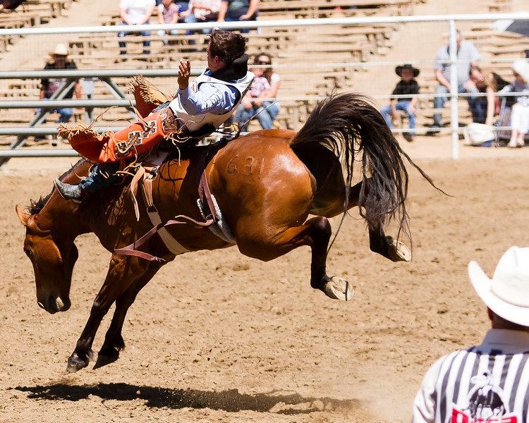 The 65th Annual Woodlake Lions Club Rodeo took place on Mother's Day weekend at the Woodlake Rodeo grounds in Elderwood. A bareback bronc contestant rides as the PRCA judge looks on.