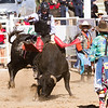 The 65th Annual Woodlake Lions Club Rodeo took place on Mother's Day weekend at the Woodlake Rodeo grounds in Elderwood. A bull-riding contestant is assisted in his ride by two bull fighters.