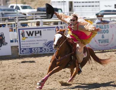 Rodeo Clown JJ Harrison kept the crowds at the 69th Springville Sierra Rodeo entertained at the weekend event. Here he show that he doesn't need any hands to ride a horse.