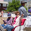 The Grand Marshall of the 69th Edition of the Springville Sierra Rodeo, Mariann Sanders, waves to the crowd as she is escorted around the rodeo arena.