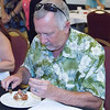 A judge sampling one of the steak entries at the 8th Annual Food Fight for Families held at the Visalia Wyndham Hotel to benefit the Visalia Rescue Mission.