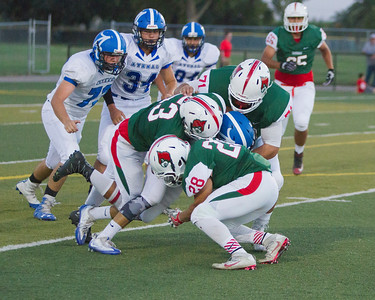 A host of Lindsay Cardinal defenders converge on the Avenal ball carrier in the Cardinal 15-8 victory over the Buccaneers.