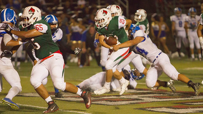 Lindsay RB Juan Cisneros (21) rushes the football in the Cardinal's 15-8 victory over the visiting Avenal Buccaneers.
