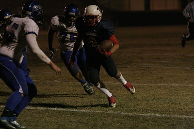 Strathmore Spartan runningback carries the football against the Avenal Buccaners in their Central Section Division VI Semi-final game. The Spartans won 20-8.