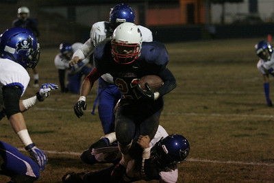Spartan Uriel Mejia (22) runs through the grasp on an Avenal defender in Strathmore's 20-8 victory over the Buccaners.