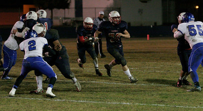 Strathmore offensive lineman Matt Redfern (70) leads runningback Uriel Mejia (22) during the Spartan's 20-8 Central Section Division VI Semifinal playoff game.