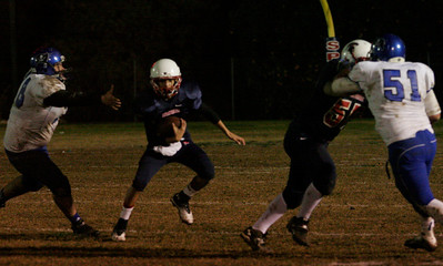 Strathmore QB Carlos Lopez rushes the ball on a keeper against Avenal.