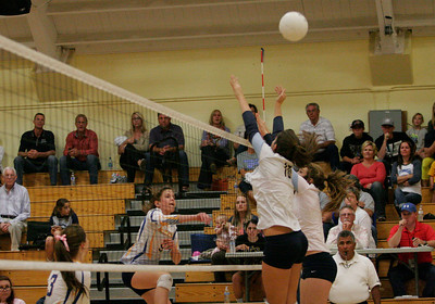 EUHS Monarch Gabi Crookshank's spike flys over the outstretched hands of CVC Cavalier Haley Hilvers (10).