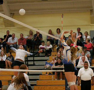 Olivia Harden (9) and Chelsa Larson attempting to block a Cavalier spike during the Exeter vs. CVC volleyball match on Friday, October 13, 2013.