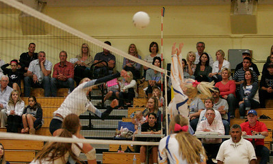 EUHS Monarch Chelsea Larson (7) skys in an attempt to block a CVC spike in Friday's match in Exeter.