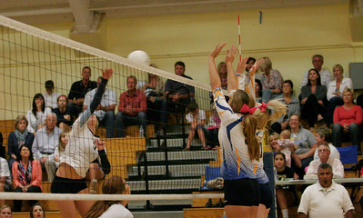 Exeter Union High Schools Olivia Harden, near, and Chelsea Larson attempt to block a spike by CVC in Fridays' match at EUHS.