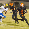 A Woodlake running back sweeps around the left end  during the Tigers 28-27 victory over the visiting Corcoran Panthers.