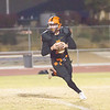 Woodlake Tiger Sophomore QB rolls out for a pass against the Corcoran Panthers in Friday's ESL match up. The Tigers scored late in the fourth quarter to beat the Panthers by a 28-27 score.